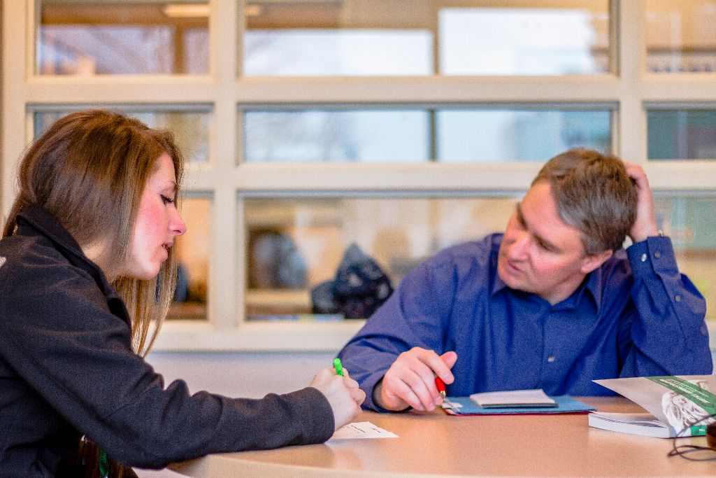Jill Shartrand, Senior, Criminal Justice, assists Aaron Nooney as a Peer Mentor in the Center for Academic Engagement