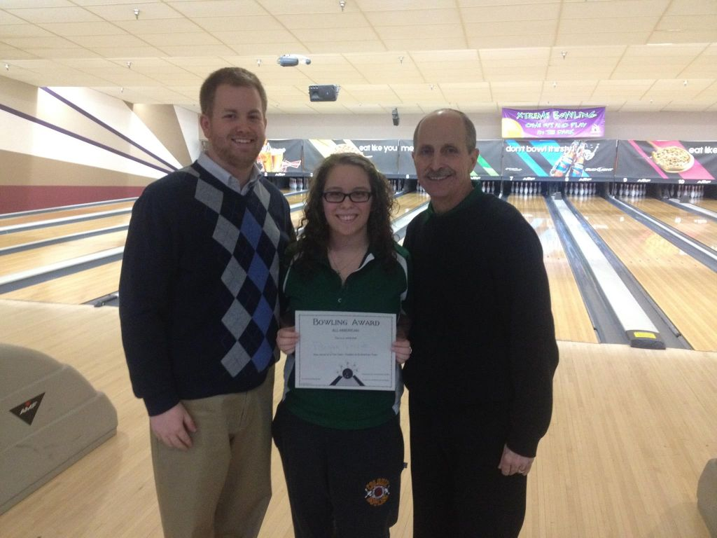 Rzeszuto receiving her award with Coach Paulsen (left) and Coach Prest (right).