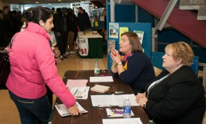 A student registers for the part time job fair and seeks advice on what employers will match her skills
