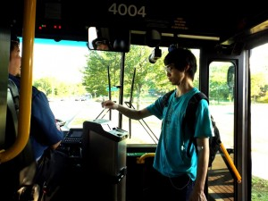 A student using his HVCC ID to board a CDTA bus on Vandenburgh Ave.