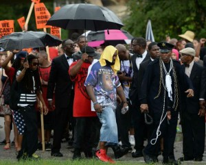 Residents in Ferguson continue to protest the killing of Michael Brown on August 30th (courtesy of Times Union)