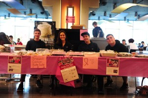 Members of Circle K club (left to right Cody Lane, Joelle Connor, John Chonuat, and Brendan Suppies hold a bake sale to benefit the American Cancer Society. Photo by Konrad Odhiambo.