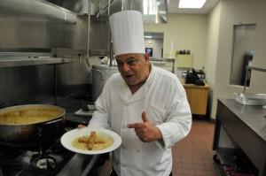 professor of the culinary program and creator of the award winning chowder shows off his creation in the EOC kitchen.