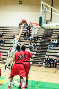 Brendan Archer drives to the hoop and floats it in. Photo by Konrad Odhiambo