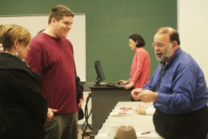 Jerome Crucetti, Engineering department instructor, speaking with a prospective student.