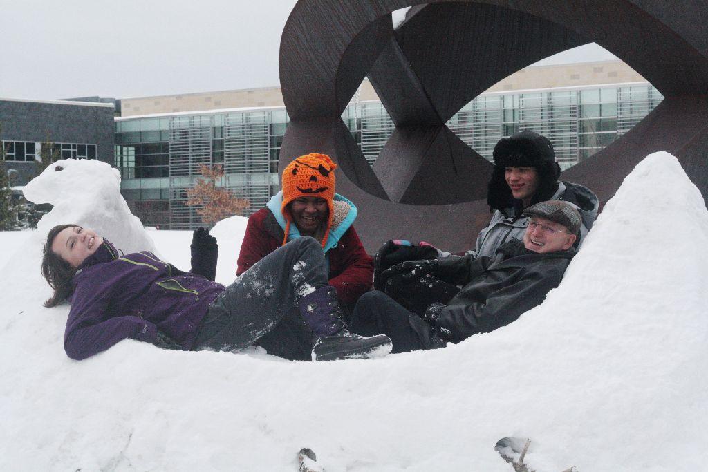 Michaela Pickett, Firdous Madany, and freshman class president Everett McNair celebrate their winning snow sculpture with college President Drew Matonak. Photo by Jefri Nazri. (1)