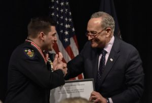 Chuck Schumer awards local officer during event on campus