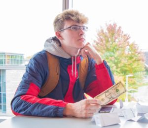 Business administration student Ryan Mizener ponders where exactly his tuition money is allocated.