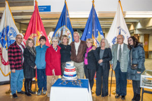 Bernard McGarry, who served as a medic during D-Day cut the cake at the reception hosted in the Marvin Library Atrium last Thursday.