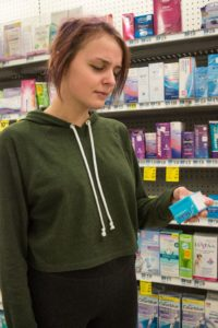 Liberal arts student Nicole Hooker needs Midol, but hates the price she has to pay for pain relief.